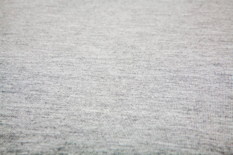 Texturerade verkliga stuckit tyg f?r ljung som gr? f?rger gjordes av syntetiska fibrer, bakgrund royaltyfri bild