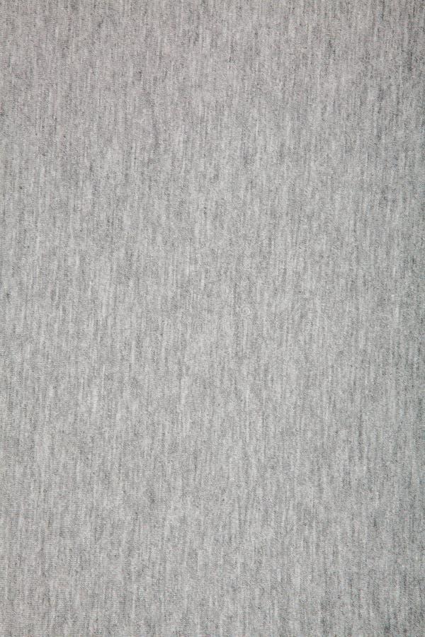 Texturerade verkliga stuckit tyg f?r ljung som gr? f?rger gjordes av syntetiska fibrer, bakgrund royaltyfria bilder