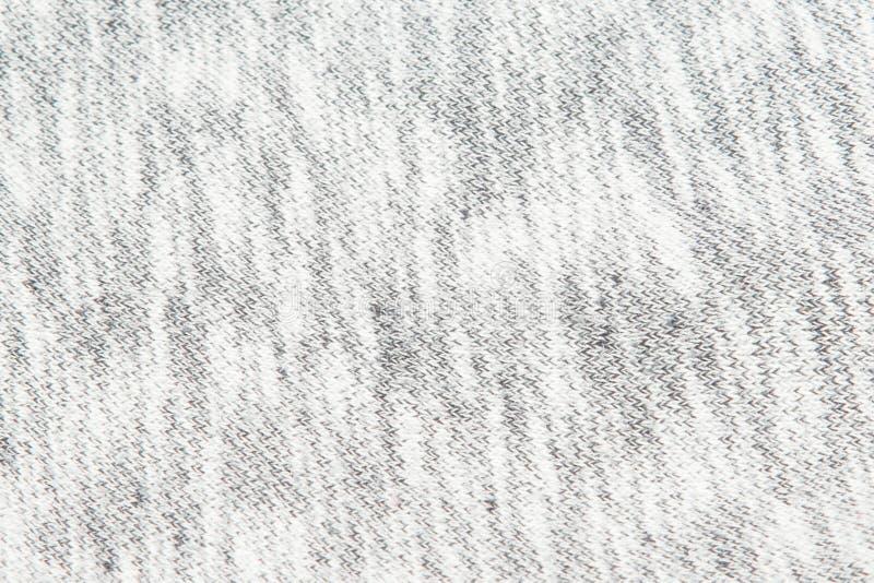 Texturerade verkliga stuckit tyg f?r ljung som gr? f?rger gjordes av syntetiska fibrer, bakgrund royaltyfri fotografi