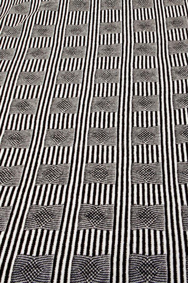 Texturerade verkliga stuckit tyg f?r ljung som gr? f?rger gjordes av syntetiska fibrer, bakgrund arkivbild