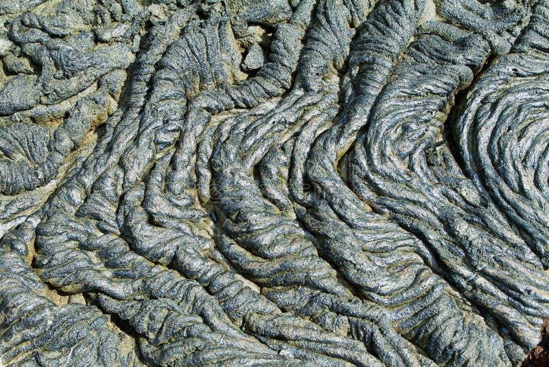 Textures of black lava (pahoehoe) in Santiago island. Galapagos, Ecuador royalty free stock photography