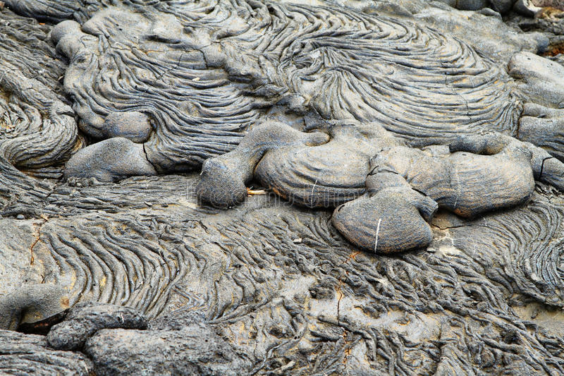 Textures of black lava (pahoehoe) in Santiago island. Galapagos, Ecuador stock photography
