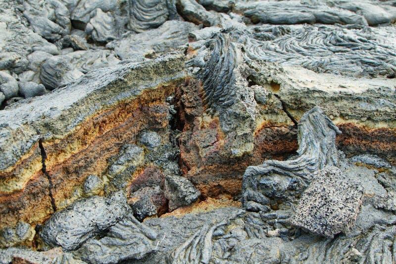 Textures of black lava (pahoehoe) in Santiago island. Galapagos, Ecuador royalty free stock photo