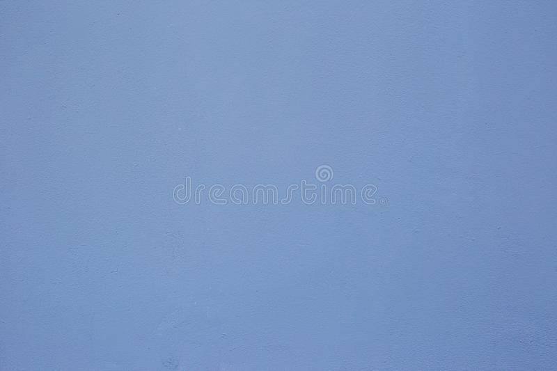 Textures on the blue wall, for background. Plastered concrete wall, painted in blue, surface texture. royalty free stock photos