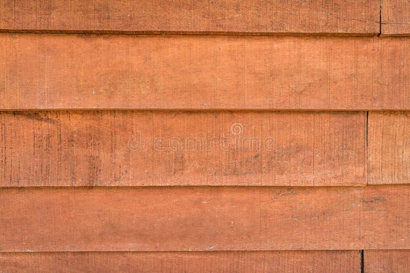 Textures de fond ou vieux papiers peints en bois étendus dans horizontal et orange-clair dans le rétro style photographie stock