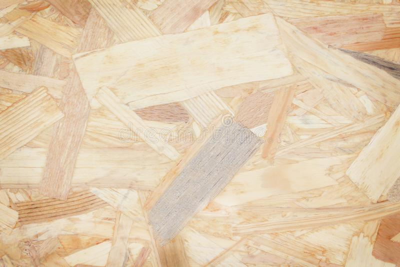 Texturfragment av ett plattaavfallsträ, kryssfanerabstrakt begreppbakgrund, naturlig modellåteranvändning royaltyfri bild