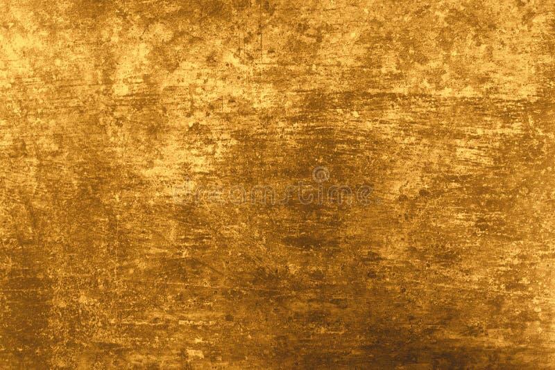 Texturice el color oro natural del yeso La pared del fondo es concreta y de piedra naturales foto de archivo