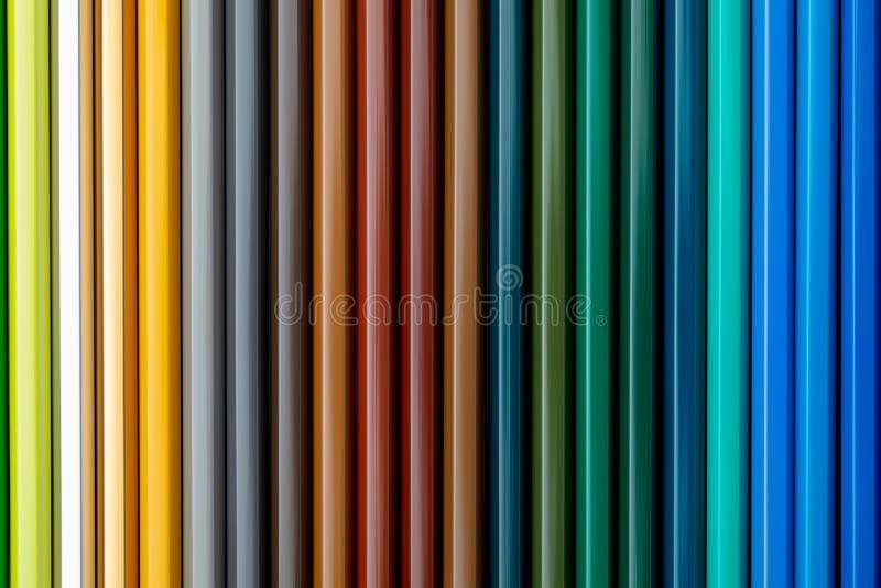 Texturice los lápices coloreados foreground Colores de la caída y del invierno Comienzo de la escuela, de clases Papel pintado he fotos de archivo