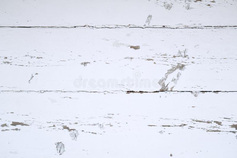 Texturice - una pared de madera, blanca con los rascados fotografía de archivo