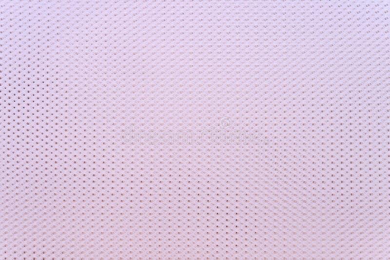 Texturizó un fondo de los géneros de punto de pálido - color rosado foto de archivo libre de regalías
