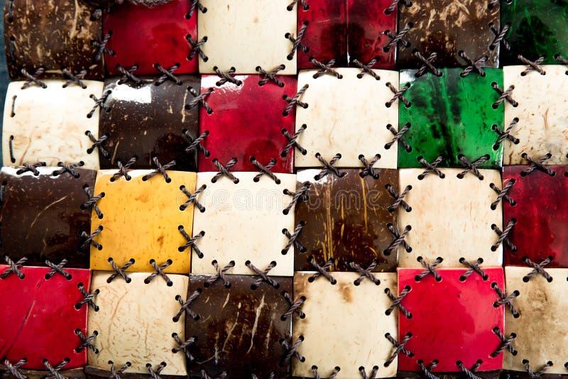 Texturmosaikkokosn?t T?tt g?ras dekoren av naturliga ecomaterial Textur f?r palmtr?dfibersk?ll med repet f?rgrikt fotografering för bildbyråer