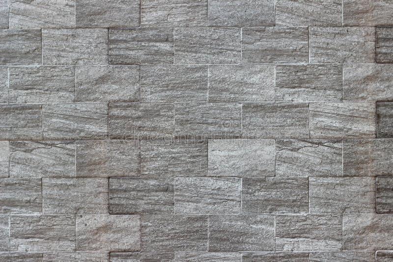 Texturtegelstenv?gg, brickly gr?a tegelplattor f?r n?rbild arkivbilder