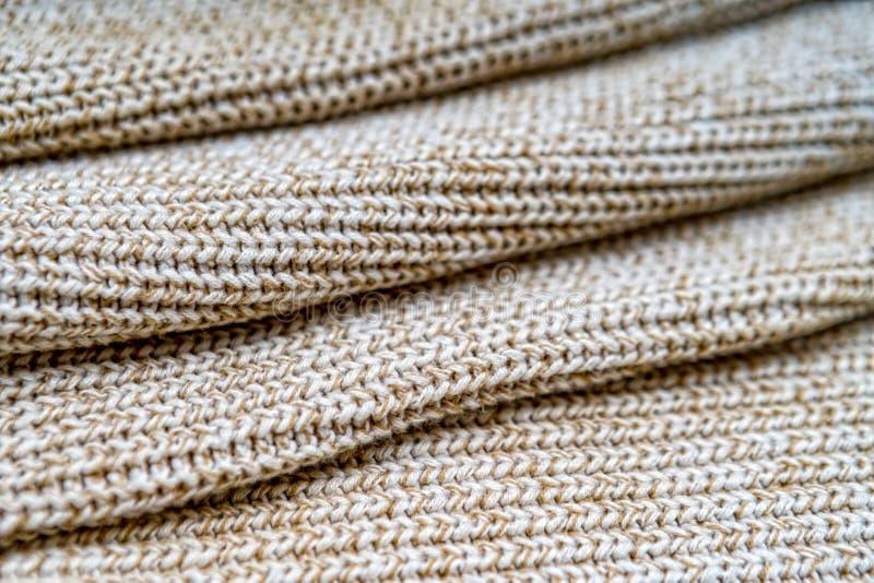 Textuur als achtergrond van gebreide die stof van katoenen of wolclos wordt gemaakt stock fotografie