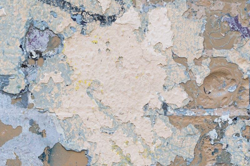 Textuur, bakstenen muurachtergrond Muurfragment met vlekken van oude verf royalty-vrije stock fotografie