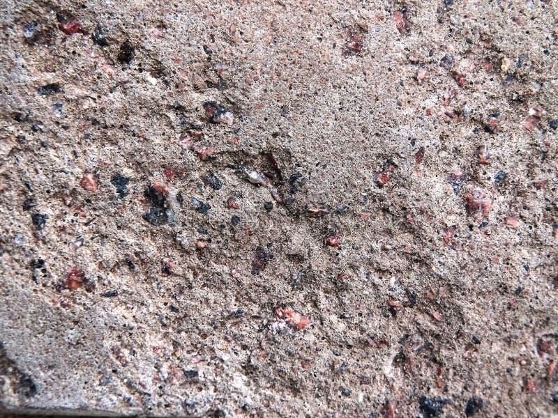 Textuur, grijze poreuze muur De textuur van de rots Oude, ruwe, geruïneerde oppervlakte royalty-vrije stock fotografie
