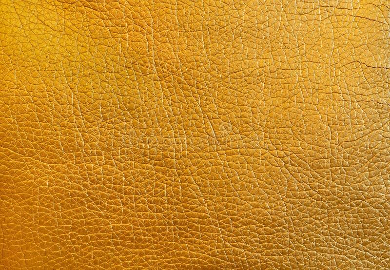 Textuur metaal gouden leer als achtergrond Sluit omhoog royalty-vrije stock fotografie