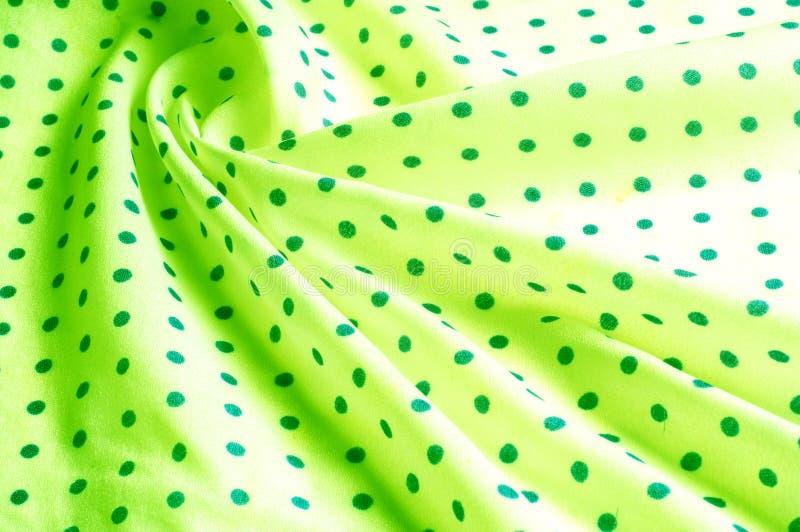 Textuur Tekening Achtergrond de zijdestof is groen, polka dit stock fotografie
