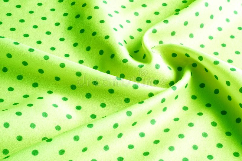 Textuur Tekening Achtergrond de zijdestof is groen, polka dit stock foto