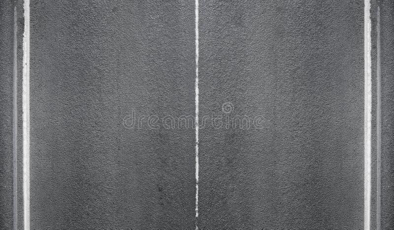 Textuur van asfaltweg met het merken van lijnen royalty-vrije stock afbeeldingen