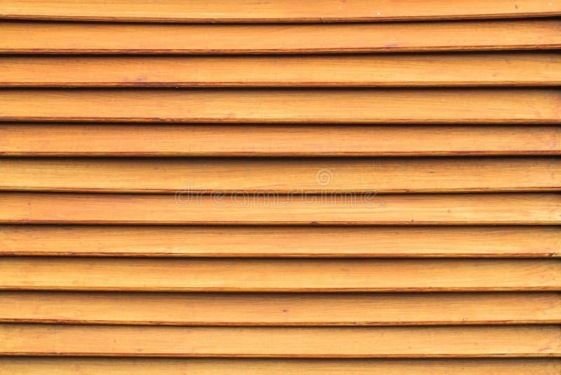 Textuur van bruine houten latmuur voor achtergrond stock foto