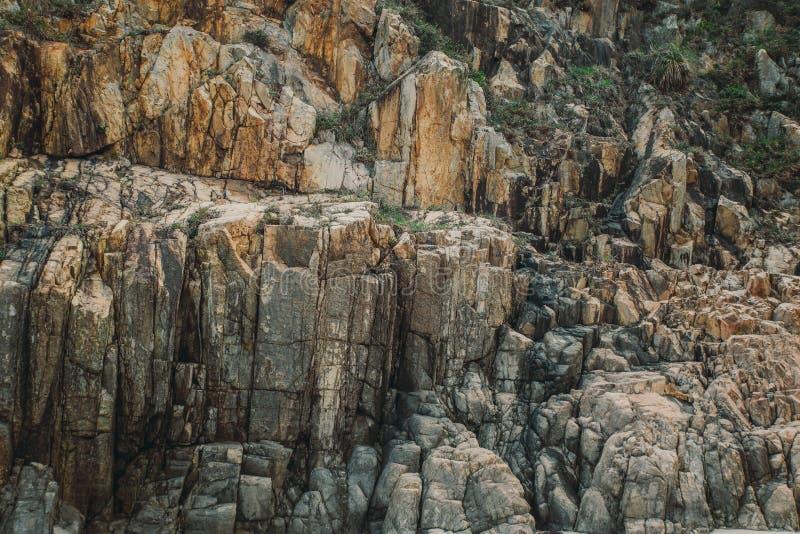 Textuur van de de klippenachtergrond van de rotssteen royalty-vrije stock foto