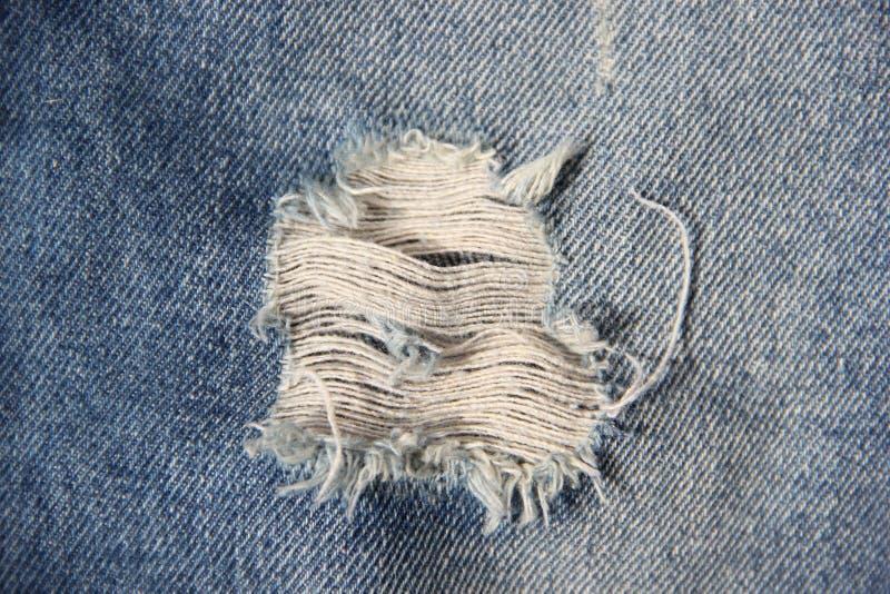 Textuur van de denim de jeans gebroken stof royalty-vrije stock fotografie