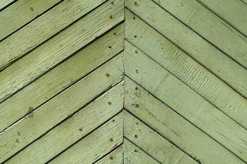 Textuur van de oude uitstekende houten die raad in groen wordt geschilderd royalty-vrije stock afbeelding