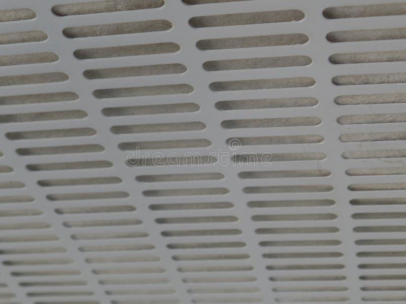 Textuur van de platen van de keukenuitlaat, witmetaal met gaten royalty-vrije stock foto