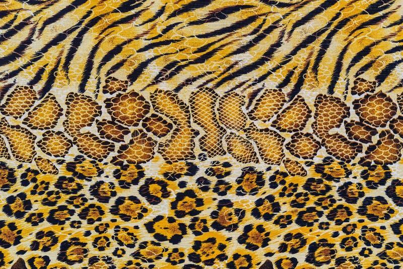 Textuur van de strepentijger van de drukstof en slangleer stock afbeeldingen