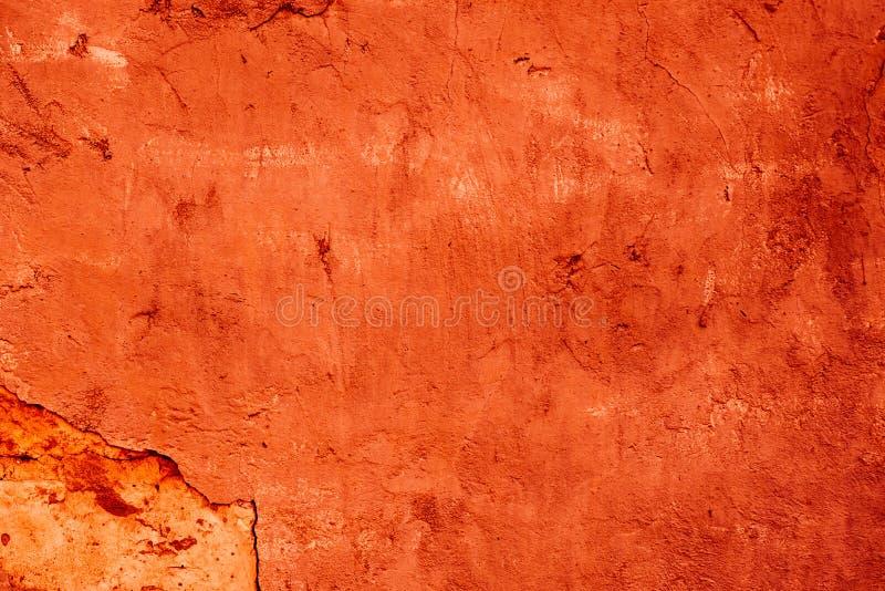 Textuur van een dilapidated oranje decoratief pleister Abstracte achtergrond voor ontwerp royalty-vrije stock afbeeldingen