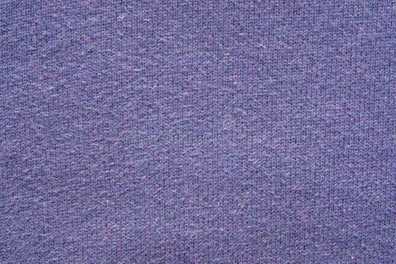 Textuur van een wolgaren van violette kleur stock afbeeldingen