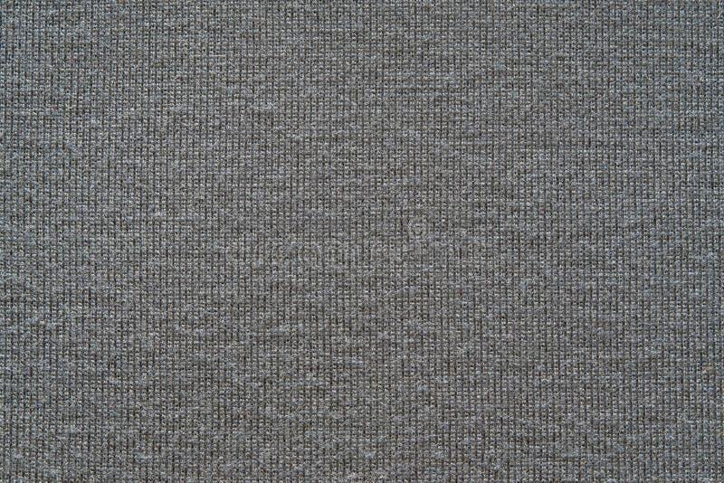 Textuur van een zachte gebreide stof van grijze kleur stock foto's