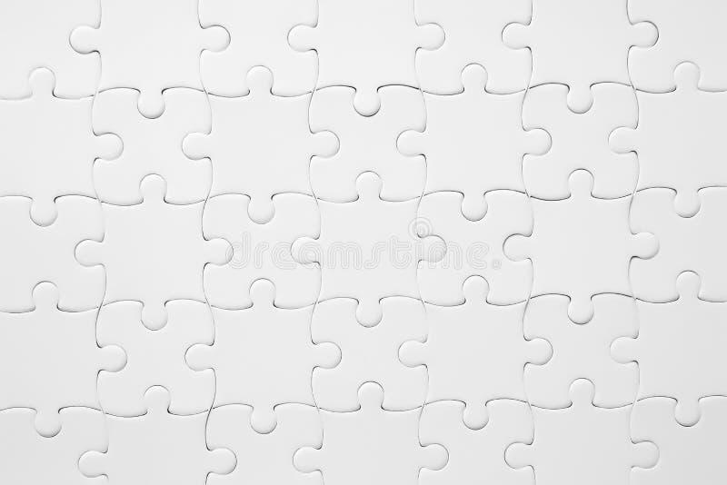 Textuur van geassembleerd raadsel als achtergrond stock foto's
