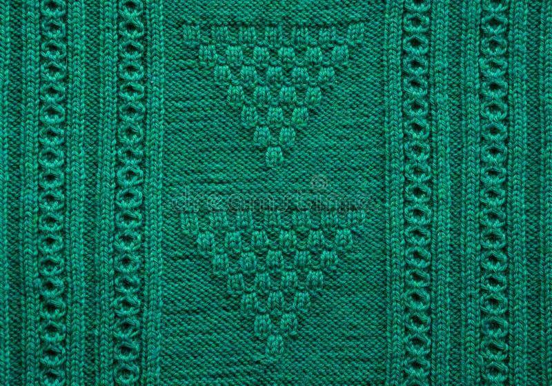 Textuur van gebreide met de hand gemaakt Dichte omhooggaand van de Kerstmis groene sweater abstracte achtergrond royalty-vrije stock foto's