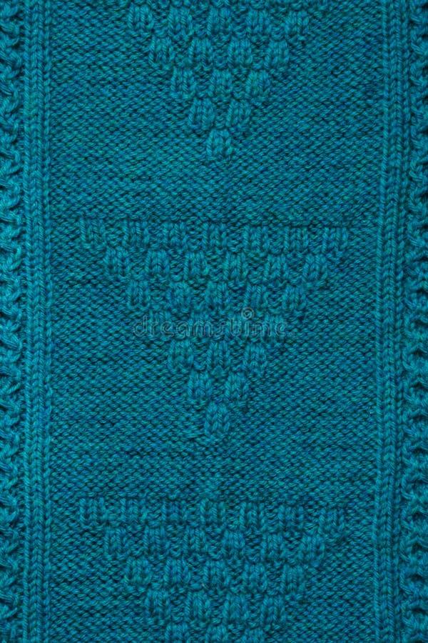 Textuur van gebreide met de hand gemaakt Dichte omhooggaand van de Kerstmissweater abstracte achtergrond stock foto