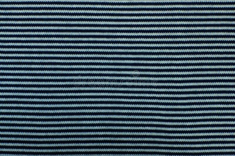 Textuur van gebreide stof voor een achtergrond stock afbeeldingen