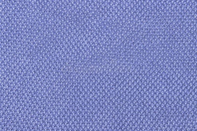 Textuur van gebreide stoffen blauwe achtergrond dicht omhoog royalty-vrije stock afbeelding