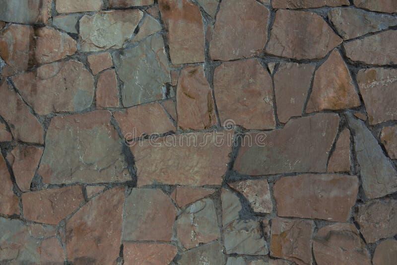 Textuur van gescheurde steen Bruine steenmuur royalty-vrije stock foto