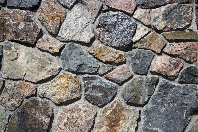 Textuur van gevoerd natuursteen Achtergrond voor ontwerpers stock afbeelding