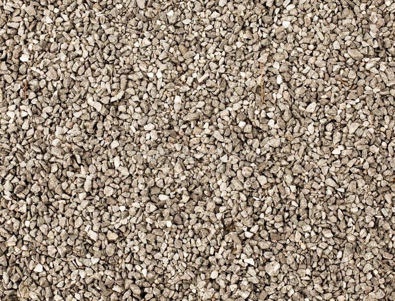 Textuur van grijs grint op grond stock afbeelding