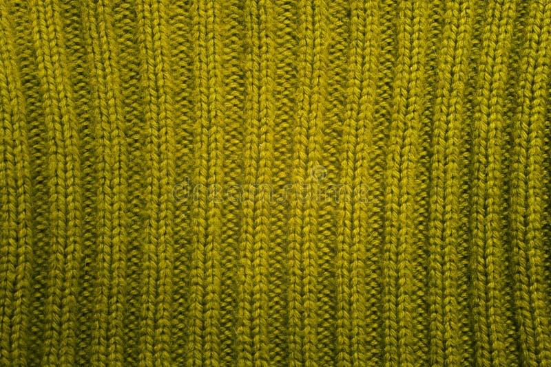 Textuur van groene gebreide wolsweater royalty-vrije stock afbeeldingen