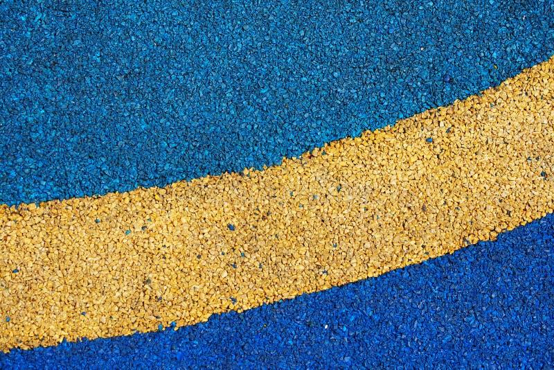 Textuur van kleuren rubbervloer op speelplaats royalty-vrije stock foto