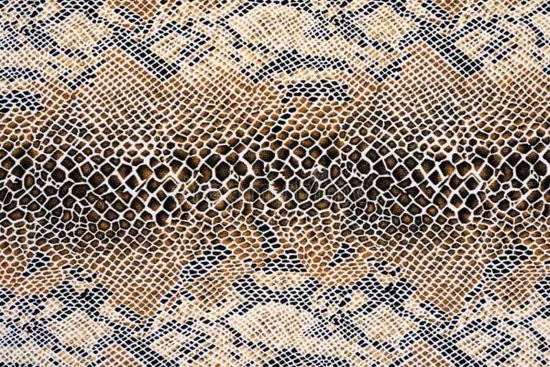 Textuur van leer van de stoffen het gestreepte slang stock afbeelding