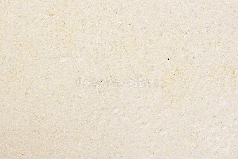 Textuur van licht roomdocument, achtergrond voor ontwerp met exemplaar ruimteteksten of beeld Het rekupereerbare materiaal, heeft stock foto's