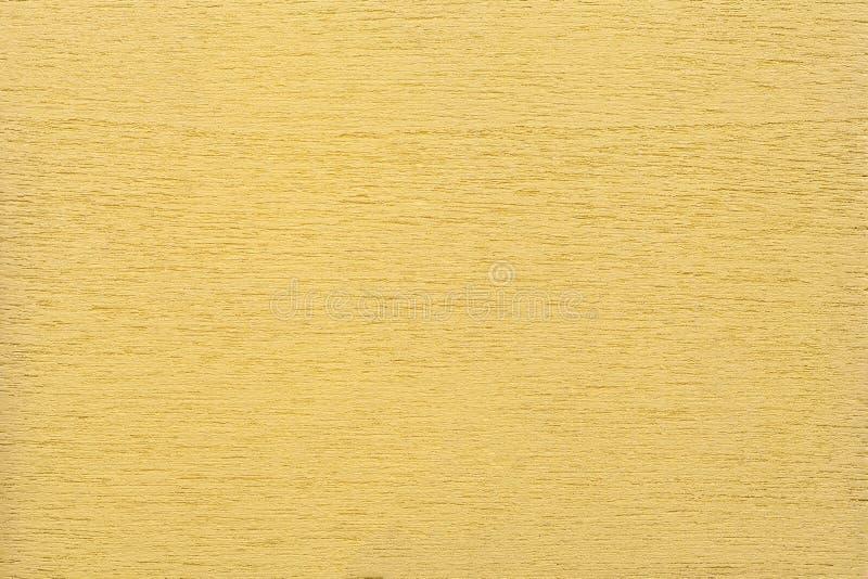 Textuur van lichtgele schone bosrijke achtergrond, close-up Structuur van het geschilderde hout, triplexachtergrond stock afbeeldingen