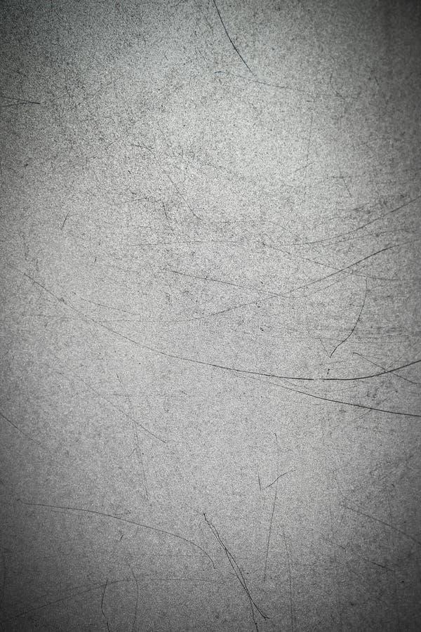Textuur van metaal met lange zwarte krassen op de oppervlakte Grijze metaalachtergrond royalty-vrije stock afbeeldingen
