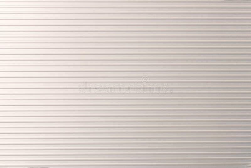 Textuur van metaal zilveren gestreepte aktentas Zilveren achtergrond stock foto's
