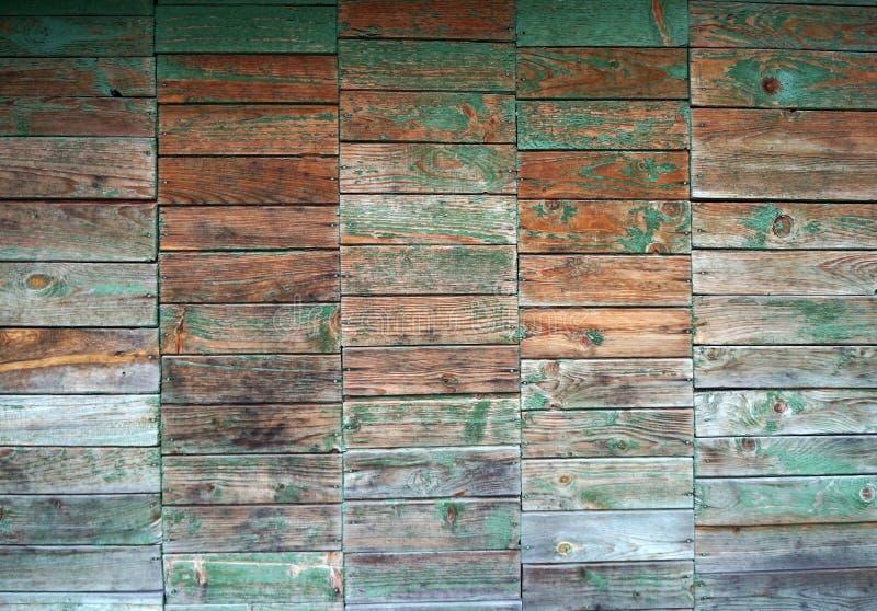 Textuur van muur die van planken met verf weg schil wordt gemaakt stock fotografie