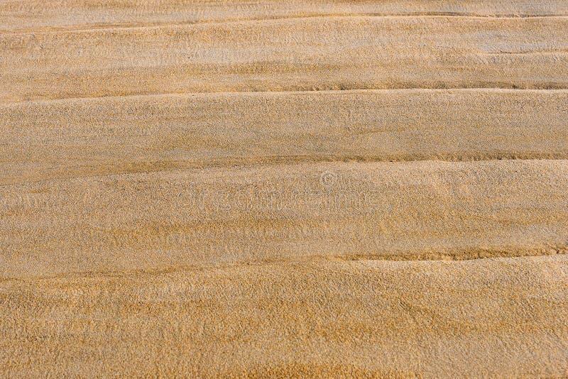 Textuur van nat zand op het strand royalty-vrije stock foto's