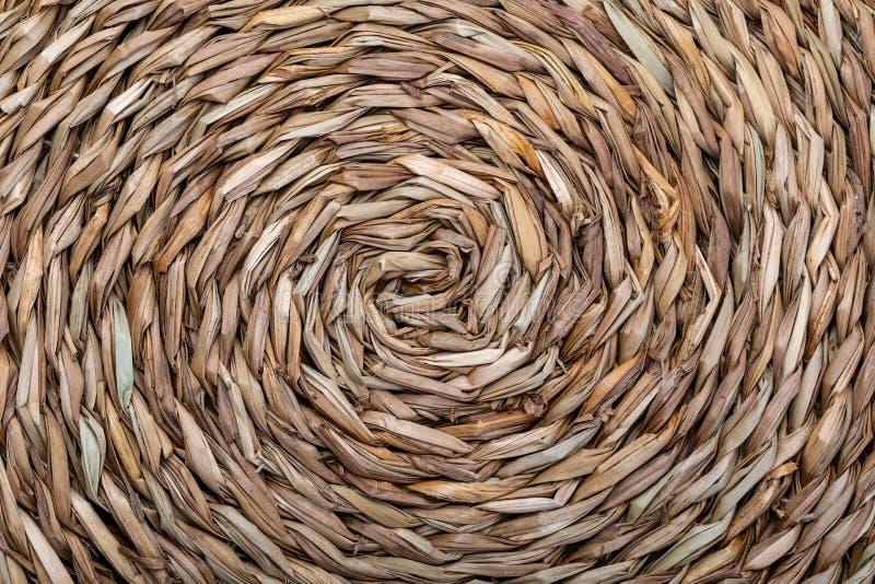 Textuur van natuurlijke vezels in een cirkelrichtingsspiraal stock foto